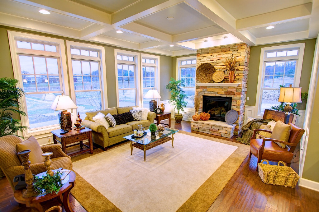 Interior photos of the cottage and village towne model Model home family room pictures